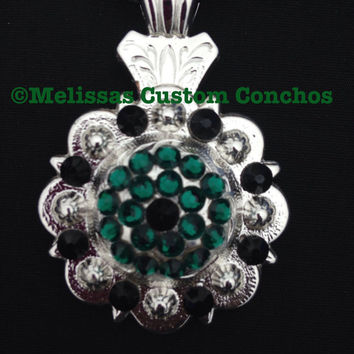 Shiny Silver concho necklace with Emerald Green and Jet Swarovski crystals. Comes with a black braided 18 inch leather cord.