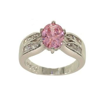 Oval Pink Cubic Zirconia Silvertone Fashion Ring with Two Rows of Channel Set Cubic Zirconia on Each Side