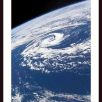A subtropical cyclone, framed black wood, white matte