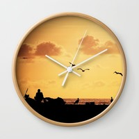 Fisherman at sunset Wall Clock by Claude Gariepy