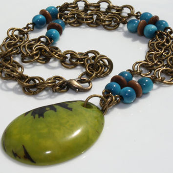 Lime Green and Brown Tagua Nut Pendant with Antique Brass Rings and Turquoise Blue and Brown Tagua Nut Beads