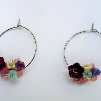 Silver tone hoop earrings with  glass flowers
