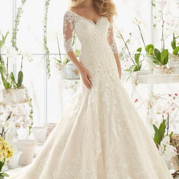49c4439b09 OffWhite $1525.00. Mori Lee 2812 3/4 Sleeve Lace Fit & Flare Wedding Dress