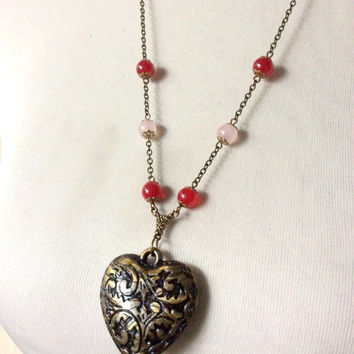 The Mending Heart Long Necklace: distressed vintage heart pendant with red and pink beaded chain