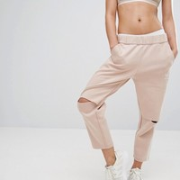 adidas Three Stripe Sweat Pants With Slit Knees at asos.com