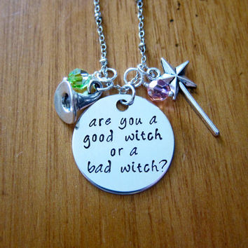 Good Witch/Bad Witch Halloween Necklace. Are you a good witch or a bad witch? Witch Hat, Magic Wand, Swarovski Crystals. Silver colored.