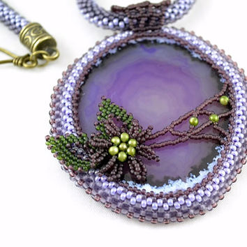 Bead Embroidery Necklace. The image on the agate beadwork, rope