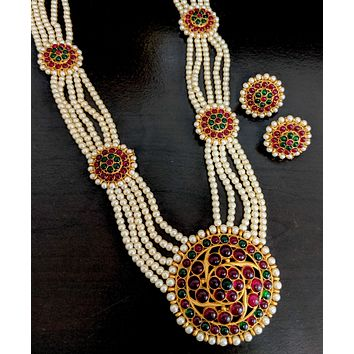 Traditional orangish faux pearl multi stranded kemp stone embedded long haram necklace and earring set