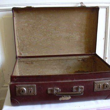 French vintage travel suitcase, antique luggage.