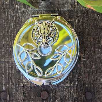 Into The Woods Solid Perfume by Strange Karma In A Beautiful Reusable Wolf Embellished Compact with Scents of Cedar, Fir and Citrus