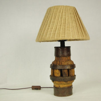 Old rustic handmade wagon wheel hub lamp with burlap lampshade
