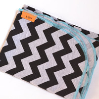 Chevron baby blanket. Blanket size: Size 31 by 40 inches. Colors- Black and gray with blue edging.