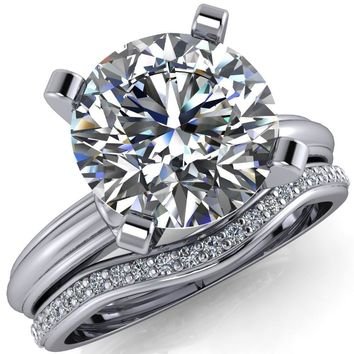 Evie Round Moissanite 4 Prong Solitaire Engagement Ring