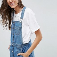 ASOS Denim Overall Button Through Mini Dress in Midwash Blue at asos.com