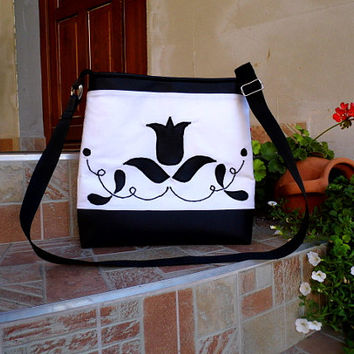 Black and white purse with flower pattern