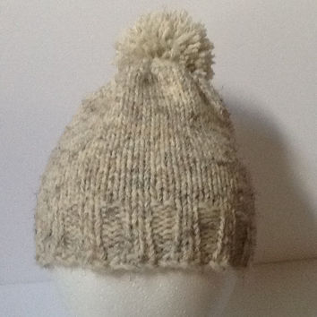 Knitted beanie hat with pompom in cream yarn,  warm and cozy sized to fit  average head