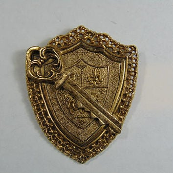 Gold Tone Shield Crest with Key Brooch Vintage Costume Jewelry