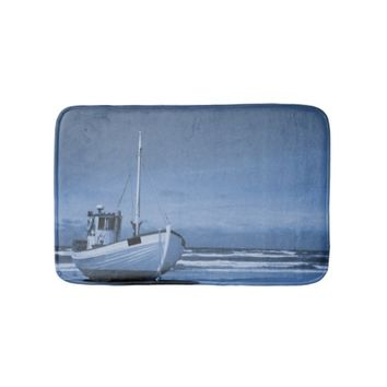 Traditional wooden fishing boat in blue bath mats