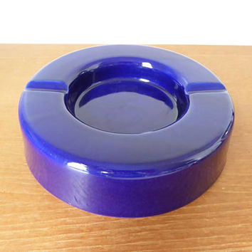 Large round cobalt blue pottery ashtray, 8 inches wide and 2.25 inches high