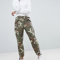ASOS DESIGN cargo pants in camo at asos.com