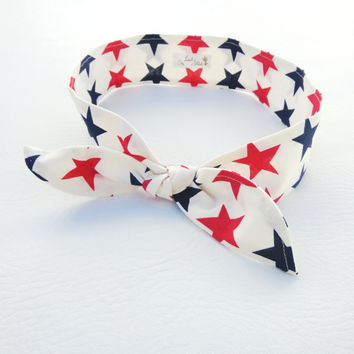 The Seeing Stars Headband red and navy blue stars on a white background dolly bow headband inspired by vintage fashion