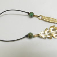 "Leather and brass leaf bookmark. 8"" beads and wirewrap"