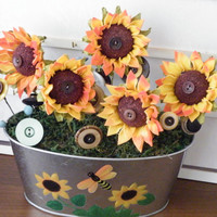 Sunny sunflowers in a metallic silver flower pot