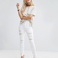ASOS PETITE Ridley Full Length High Waist Skinny Jeans in White with Shredded Rips at asos.com