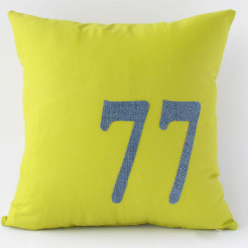 "14"" x 14"" Chartreuse pillow cover with ""77"" appliqued in a denim material."