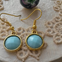 Classic earrings with a light blue turquoise cabochon charm, metal charm, light blue earrings