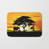 Wild Animals on African Savanna Sunset Bath Mat by bluedarkatlem