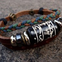 Genuine leather bracelet with tribal carved bead