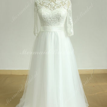 Flowy Ivory A line boho lace wedding dress with middle calf sleeves and keyhole back