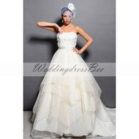 Strapless empire waist ball gown wedding dress