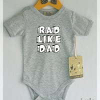 Rad like dad baby bodysuit. Baby boy or baby girl clothes. Modern baby clothes