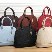 Coach Women Leather Handbag Tote Shoulder Bag Clutch Bag Cosmetic Bag Set Three-Piece-1