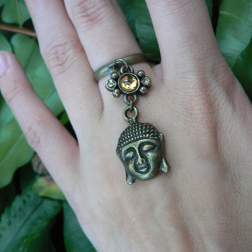 brass buddha ring with golden amber colored  cabochon