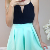 Green Pleated Mini Skirt