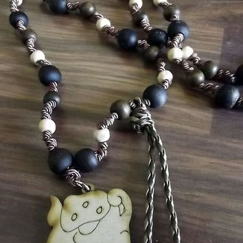Vinal Muan Maya. Maya lunar calendar. Along with jojoba, wood and silk thread necklace. Charm wood pyrography Muan.