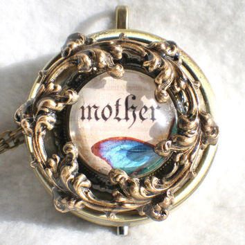 Music box locket,  round locket with music box inside, in bronze with Mother and Butterfly Cabochon