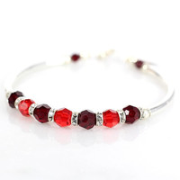 Red crystal and sterling silver fitted bracelet
