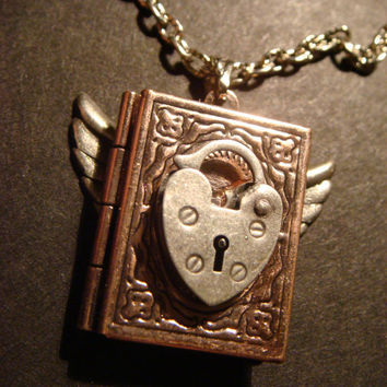 Steampunk Flying Book Locket with Heart Lock in by CreepyCreationz