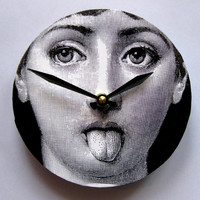 The lady has attitude.  Small Fornasetti digital face wall clock.