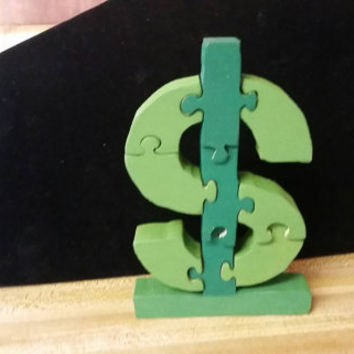 Hand made wooden dollar sign puzzle for children or adults