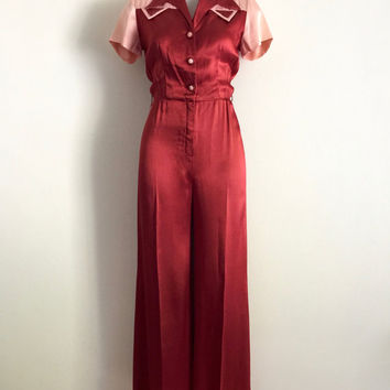 Vintage 1970s 'Stitches' rust flared satin jumpsuit with button front, contrast pink yoke and sleeves