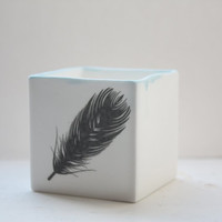 Small snow white cube made from English fine bone china and blue rims with a black feather illustration - geometric decor