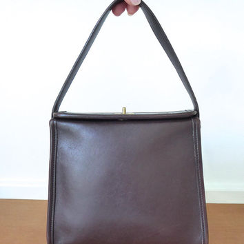 Coach small brown leather geometric handbag with top handle, style 9043 in very good condition
