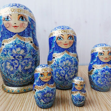 Russian matryoshka dolls in the style of Gzhel kod954