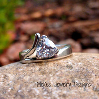 Sterling silver with Trillion cut CZ diamond like stone ring. Thick metal band.