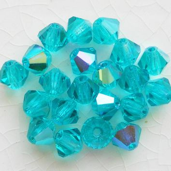 Lot of 24 4mm Blue Zircon AB Czech Preciosa Crystal bicone beads, faceted glass blue AB bicones C5601